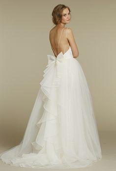Brides: Blush by Hayley Paige. Fitted slim sheen lace bridal gown with organza and tulle illusion overskirt.