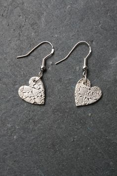Lightly textured with a heart pattern these heart shaped fine silver earrings are hand polished to a matt finish and hung on sterling silver ear wires. The heart measures approx long. Heart Jewelry, Clay Jewelry, Jewellery, Silver Earrings, Drop Earrings, Heart Shaped Earrings, Denim Bag, Heart Patterns, Metal Clay