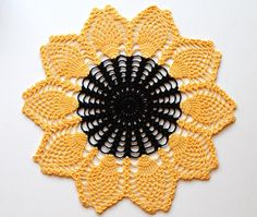 This item will be made to order and will be ready for shipment within 3 business days. This pretty doily is crocheted in a beautiful black/yellow cotton thread in a sunflower design. It measures 12 (30 cm) across. The doily is becoming a lost art. I hope one would fit the interior of your home. This doily in another fantasy color: www.etsy.com/listing/524037821/crocheted-doily-sunflower-pineapple?ref=shop_home_active_1