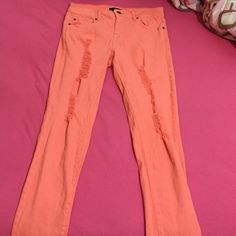Coral distressed jeans I know in the pics it shows 3 dif colors, but its more of a coral color in person. Worn a few times but still in good condition :) Forever 21 Pants