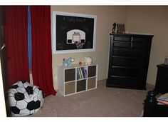 Toddler boys, rustic themed sports room.. Love the chalkboard & basketball hoop..