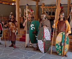Celtic Re-enactors. Shield of warrior to the left seems a bit off, as does the leather armour of the Celt on the right. There is evidence for Celts wearing a tube and yoke cuirass, presumed to be made of leather, however the one in this image looks of more medieval design.