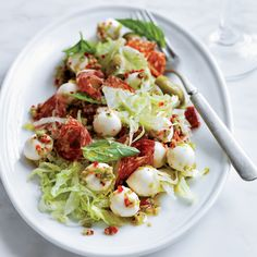 Nancy Silverton gets the biggest flavor from the simplest ingredients in this salad. She combines crisp iceberg lettuce, milky mozzarella, spicy-tangy peperoncini and salty olives and salami.