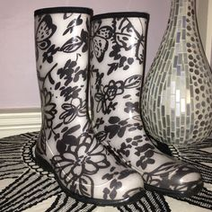 Patterned Rain Boots White and black, flower/butterfly patterned rain boots, very lightly worn, size 9 Kamik Shoes Winter & Rain Boots