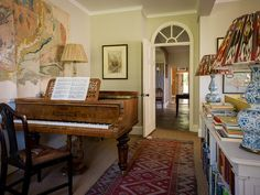 Beautiful room....the low bookcases, wood floor, rug, lamps, arched doorway, not the mention the piano (Dorset   Ben Pentreath Ltd)