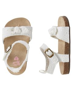 Your hunt for the perfect crib shoes is over! These baby sandals with eyelet details help her crawl from point A to point B in style.