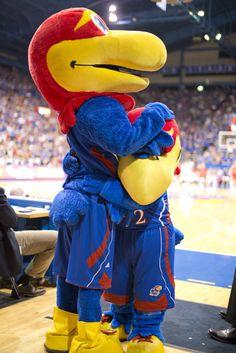 Big Jay and Baby Jay share a hug between basketball action.