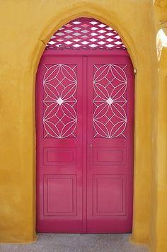 Pink door in Symi, Greece - Photography by KerrySilver, via Flickr