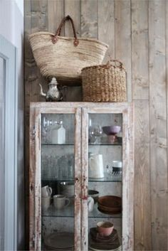 love how the bag and basket are displayed above the cabinet