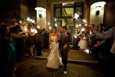 A sparkling send off for Sasha and John Pyatt from their wonderful wedding reception at DoubleTree Charleston Historic District! Photo by Red Shutter Studio.