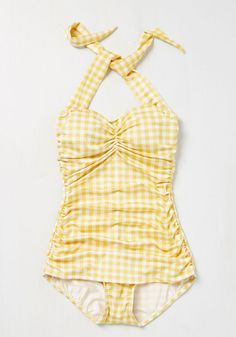 It's ModCloth's ultimate swimsuit - now in a yellow gingham print! The holy grail of swimwear, this swimsuit by the iconic Esther Williams features low-cut legs, flattering side ruching, and a retro fit that wows on many body types. Flaunt your flair for vintage fashion by making a splash in this bold look!