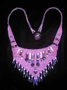 """""""Purple Passion"""" - 2012 - Fixed Length Choker, Vintage Button, Glass beads.  SOLD. Woven by Terri Scache Harris, theravenscache.shutterfly.com   Hand woven, handwoven, weaving, weave, needleweaving, pin weaving, woven necklace, fashion necklace, wearable art, fiber art."""