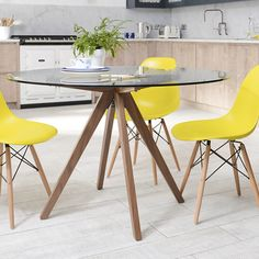 Tempered glass round dining table with walnut legs. It can accommodate 4 people for your dining.