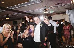 wedding photographer balboa bay club resort newport beach bride and groom dancing