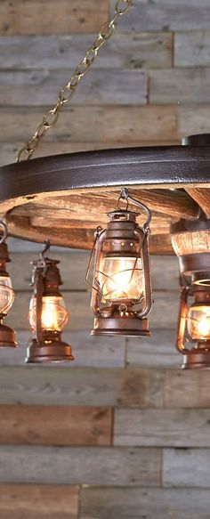 Maybe great for an outdoor patio... Rustic Wagon Wheel & Lantern Lighting-SR