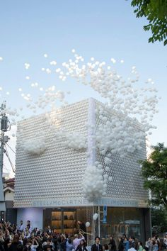 Material juxtaposition: fullness of balloon with the air circulation of building (due to holes) balloons+mesh? Stella McCartney's Flagship Store in Aoyama, Tokyo featuring biodegradable balloons.