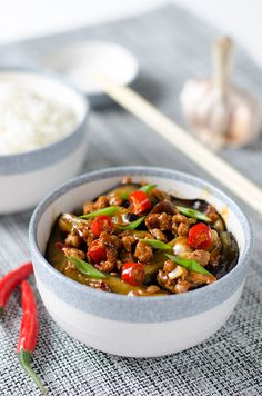 SZECHUAN SPICY EGGPLANT 鱼香茄子 (Cook time:15 mins; Serves: 2) ==Ingredients== 1 large long eggplant, 1 1/4 t salt, 3 t cornstarch, 2 t light soy sauce, 1 T Chinkiang Vinegar (black rice vinegar), 1 t Shaoxing wine, 2 t sugar, 2 T + 1 t peanut oil, 1 T minced garlic, 1 t minced ginger, 100 g ground pork, 1 t Doubanjiang (chili bean paste), 2 fresh Thai chili peppers/1 pepper for less spicy dish====
