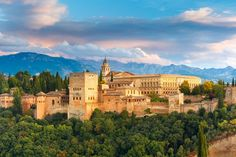 Palace and fortress complex Alhambra with Comares Tower, Palacios Nazaries and Palace of Charles V during sunset in Granada, Andalusia, Spain