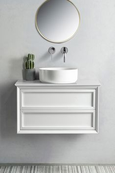 The Penley range of stunning contemporary wall hung vanities will surely make a statement in any master bathroom or ensuite. Featuring an easy to clean white Quartz top and solid wood cabinet. Available in White or Dark Oak Veneer timber finishes. #bathroomvanity #wallhungvanity #contemporarybathrooms #bathroomdesign #modernbathrooms #schotshomeemporium #schots