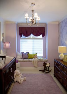 This lavender nursery is a perfect balance of charm, sophistication and whimsy. Likewise, the furniture and accessories add just enough weight on both sides of the room to keep the scales even, while a cozy window seat serves as the fulcrum.