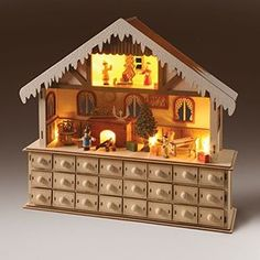 Start your own family tradition with this enchanting advent workshop Kids will love playing with the figurines and finding surprises in each drawer 10 LED lights illuminate each room in Santa's house (cordless, runs on 2 AA batteries)