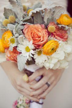 Succulents, peach roses, yellow ranunculus, white hydrangea, craspedia + daisies