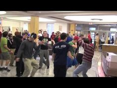 Video of a silent dance flash mob by teens at a Miami library.