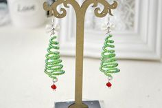 Use seed beads to makewire Christmas tree earrings that are as fun to make as they are to wear. A...