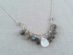 Handmade Silver Necklace with Labradorite, Moonstone cascade. Made by Amber Bryce, jewelry artist from Nashville, Indiana. Amber designs luxurious, bohemian-inspired jewelry using recycled sterling silver and gemstones.