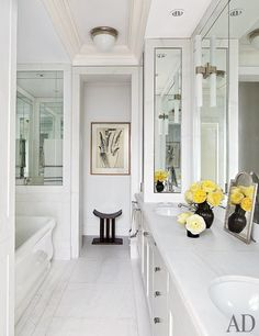 The master bath's ceiling light is by Urban Archaeology, and the sconces and tub are by Waterworks.