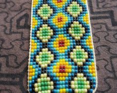 Items similar to Guacamayos/Macaw Thick Bracelet- 31 bead (Colombia) on Etsy Bead Loom Patterns, Peyote Patterns, Beading Patterns, Collar Indio, Prayer For Health, Beaded Jewelry, Beaded Bracelets, Native American Beadwork, Tear