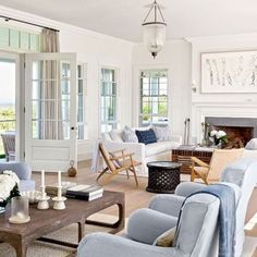 Visit Victoria Hagan's Nantucket Home : Architectural Digest - New England style, blue living room chairs, light filled family room, beautiful house Coastal Living Rooms, My Living Room, Home And Living, Living Spaces, Long Living Rooms, Cottage Living, Hamptons Living Room, Living Room Decor Set, Coastal Cottage