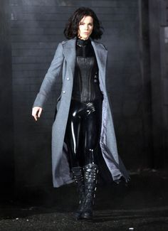 """Black latex catsuit and corset designed by Wendy Partridge for """"Underworld"""" series (© 2003). Photo from """"Underworld: Awakening;"""" Directors: Måns Mårlind and Björn Stein; Costumer: Monique Prudhomme; Starring: Kate Beckinsale as 'Selene;' Lakeshore Entertainment (© 2012)."""