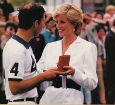 27 July 1986:Princess Diana at Cartier International Polo Match Wearing a white jacket and wide black belt with green shin length skirt. Smith's Lawn Windsor