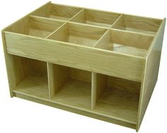 """6 upper bins and 6 lower compartments each have a clear width of 13"""". The bottom compartments are 13"""" high. On casters for easy mobility. Dimensions are 41-1/4"""" long by 28-3/4"""" wide by 24-1/2"""" high. Shipped fully assembled, ready-to-use. $549 per unit.  Does not include shipping.    Two of these, plus one Classmate (4 bins instead of 6) replaces the space of six 3'x1'x4' bookcase (but handles half as many books).  Need double that."""