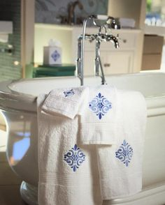 Brighten up your bathroom with these beautiful blue embroidered Almafi Scroll styles. Discover the collection now via link in bio. #jacarandaliving #bathroom #home #bathtowel #tissueboxcover
