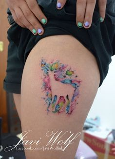 Watercolor deer tattooed by Javi Wolf   - Love the colors. Negative space with color awesome. Wouldn't get a deer though.