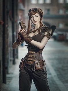 This tough, leather armored Steampunk Lara Croft look. From the Steampunk Fashion Guide's Guide to Corsets - Underbust corsets: Armed Steampunk Girl Steampunk Couture, Gothic Steampunk, Steampunk Mode, Style Steampunk, Steampunk Clothing, Everyday Steampunk, Steampunk Outfits, Renaissance Clothing, Accessoires Steampunk