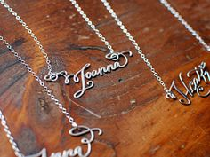 Calligraphy necklaces.