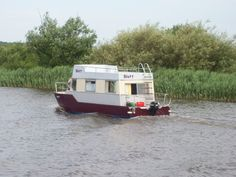 It's Blott !!   A motorised houseboat heading up the River Yare.