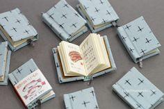 """豆本『能登のおいしいもの図鑑』。限定版のカバーは手織りの能登上布使用。 Miniature book """"delicious thing pictorial book of Noto.""""  The cover of a limited edition is handwoven Noto-jofu use."""