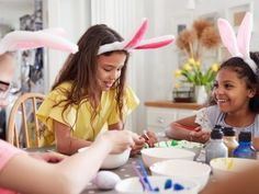 Three Girls Wearing Bunny Ears Sitting At Table Decorating Eggs For Easter At Home by monkeybusiness. Three Girls Wearing Bunny Ears Sitting At Table Decorating Eggs For Easter At Home Easter Weekend, Egg Decorating, Fun Activities, Digital Illustration, Grape Vines, Bingo, Stock Photos, Table Decorations, How To Wear
