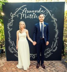 Chalk board photo booth backdrop with wedding couple