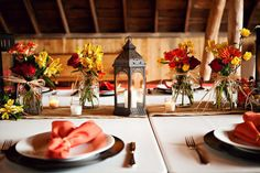 Barn wedding table setting with lanterns & candles
