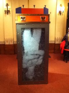 Houdini's Water Torture Cell - A reproduction of Houdini's famous Water Torture Cell, complete with a life size poster of Houdini inside, at the Houdini museum in Appleton http://historyofmagiconline.com/harry-houdini/photos-houdini-museum-appleton/