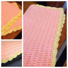 Pink and yellow crochet blanket.