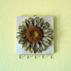 Jewelry organizer - silver sunflower - repurposed from scrap wood by Lolailo. $19.99, via Etsy.