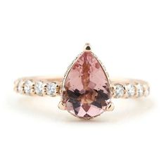 This pear shaped pink morganite ring uses diamond accents to catch sparkles from every angle, the perfect blend of unique and classic. Designed by custom jeweler, Abby Sparks Jewelry. Handmade Engagement Rings, Pear Shaped Engagement Rings, Gemstone Engagement Rings, Perfect Engagement Ring, Designer Engagement Rings, Morganite Engagement Ring Pear, Morganite Ring, Ring Verlobung, Sparkles