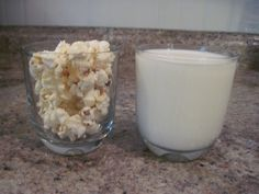 """FUN SCIENCE EXPERIMENT!   In chap. 3 of the book Farmer Boy it says: """"You can fill a glass full to the brim with milk, and fill another glass of the same size brim full of popcorn, and then you can put all the popcorn kernel by kernel in to the milk, and the milk will not run over.  You cannot do this with bread.  Popcorn and milk are the only two things that will go into the same place."""""""