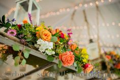 """Head table hanging window pieces created by """"WOW"""" Event Design and Coordination!  Created with vibrant colors of garden roses, alstroemeria, waxflower and various greens! Photos by Gerber + Scarpelli"""